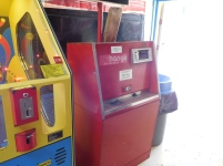 A very old coin machine.