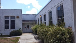 Side entrance, cafeteria is to the right and library to the left.